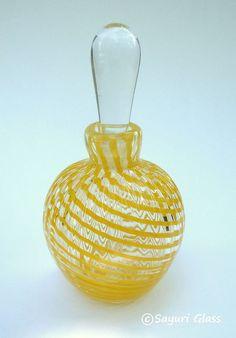 yellow glass perfume bottle