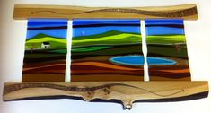 This wall hanger sculpture is approximately 120 cm long and 60 cm tall, however it can be made to any size.  The fused glass panels represent an abstract landscape.