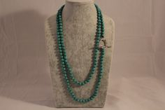 Turquoise necklace long with LARGE sterling silver toggle clasp.  Wraps around your neck 3 times.    Price includes a pair of matching earrings.