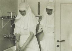 The 2 eldest children of Tsar Nicholas II of Russia, GD's Tatiana (left) & Olga in their nursing uniforms; C. 1915.
