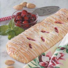 """Cherry Cheese Loaves Recipe -This has become my """"trademark"""" dessert. I'm asked to take it everywhere I go! Diagonal cuts in the dough give this coffee cake a pretty look without the extra work of braiding it. -Carolyn Gregory, Hendersonville, Tennessee"""