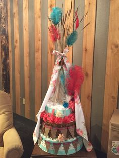Teepee diaper cake.. Well...... I'm just gonna have to find a baby shower to do this for. How fun!