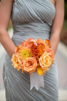 Love the grey bridesmaid dress with the pop of orange flowers - a perfect pairing of neutrals and bolds.