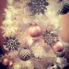 Love those blush and cream and silver ornaments on the white tree