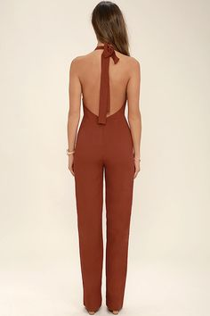 Be ready to jump into action in the Leave a Kiss Rust Red Halter Jumpsuit! Breezy woven fabric forms a tying halter neckline and seamed bodice. Open back tops chic, high-waisted pants with wide-cut legs. Hidden back zipper/clasp.