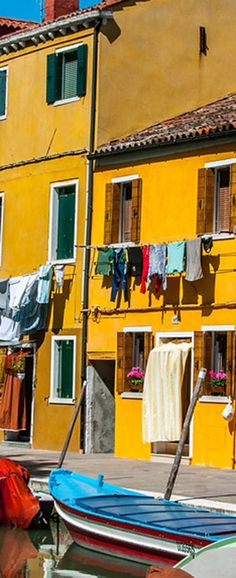 Colorful buildings in Burano, Italy. Burano is a ferry ride from Venice and is noted for it fine lacework.