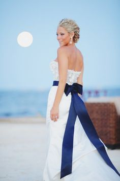 This bride is stunning in her gown: http://www.stylemepretty.com/little-black-book-blog/2014/07/21/beach-wedding-at-the-ocean-reef-club/ | Photography: Binary Flips - http://binaryflips.com/