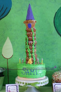 LOVE this cake for a Tangled party! (Couldn't find the instructions, but it looks like it's chocolate donuts on top of the cake, then a jumbo cupcake on top of that. Too cute!