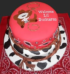 Love this little cowboy cake!    Perfect match to this theme: http://www.babyshowerstuff.com/cowebashth.html