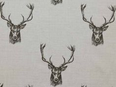 Stag head cotton curtain fabric available from our online fabric shop or fabric warehouse in Northamptonshire.