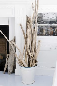Add some height to your display with a bucket of driftwood in the corner, next to your entry table.