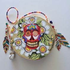 """""""SUGAR SKULL"""" ~ $ 164  ~  10inch primitive drum & beater ~ designed & hand-painted by artist:  Sharon Gilbertson  (contact artist on website)  For clothing collection - follow link on website to Sharon's VIDA VOICES shop.  Thank you."""