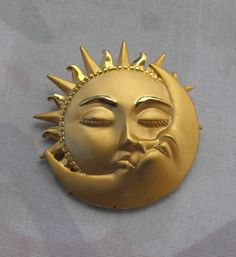 """• Main Color(s): gold • Materials: goldtone metal • Maker: JJ • Approximate Year: c1970s • Size: 2"""" diameter This splendid pin is so expressive, with a feminine sun (arched eyebrows, long eyelashes) g"""