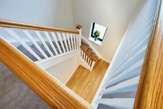 A softwood flight of stairs with a single winder turn and return balustrade. The handrail and newel caps have been create a stunning contrast against the other primed elements of the staircase. Glass Stairs, Metal Stairs, Painted Stairs, Wooden Stairs, Bespoke Staircases, Wooden Staircases, Curved Staircase, Staircase Design
