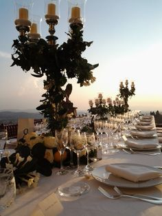 chandeliers with flowers and lemons  in Villa Gamberaia, Fiesole, Tuscany  www.stiattifiori.it