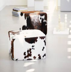 I haven't always been a fan of cowhide, perhaps because I haven't had the vision for it into the decor of the log house. Cowhide placemats and runners have just never really taken my fa… Cowhide Ottoman, Pouf Ottoman, Western Decor, Rustic Decor, Teak, Decorating Your Home, Diy Home Decor, Jan Kurtz, Monograms