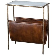 Practicality and style meet at the Strauss Magazine Table where distressed leather, an antiqued brass metal base and a marble top come together to deliver fabulous style. Features: - Antique brass, wh