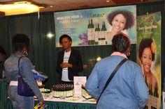 Naturaz Hair Founder Mumbi Dunjwa talking to clients at the Philadelphia Natural Hair Show