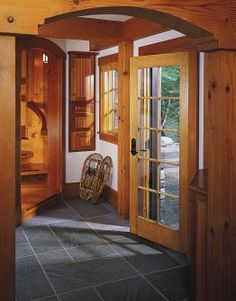 Create a rustic mudroom with the natural look of Pella Architect Series wood doors.