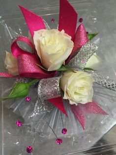 Wristlet corsage with white spray roses, hot pink and silver sparkle ribbon, hot…