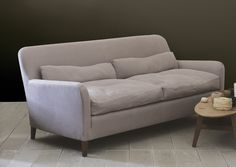 A generous cushioned sofa with a high back available in two lengths.