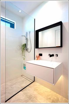 Bathroom Design Ideas - Black Shower Frames // The partial frame around the glass of the shower defines the space in a unique way and brings out the black around the frame of the mirror and on the sink hardware. Modern Small Bathrooms, Modern Bathroom, Bathroom Black, Bungalow Bathroom, Master Bathroom, Modern Architecture Design, Modern House Design, Ideas Baños, Hidden Lighting