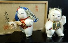 "Japanese Kaga ningyō dolls 加賀人 signed 光陽作 Kōyō-saku (made). The expression 本練 ""honeri"" refers to the type clay used for the dolls. The Kaga dolls represent the ""shishimai 獅子舞"" lion dance scene."