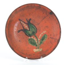 """Realized Price: $ 8,888   Bucks County, Pennsylvania redware plate, attributed to the Diehl Pottery, 19th c., with yellow and green slip tulip decoration, 8 1/2"""" dia. The Collection of Lester Breininger"""