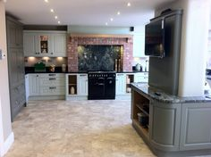 Dante Solid Oak Painted Olive & Soft Mint with Sensa Gabon Granite by Cosentino and specially selected Verde Marinace Granite - all by Homestyle Kitchens in Wigan