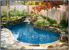 Outdoor swimming pool with waterfall