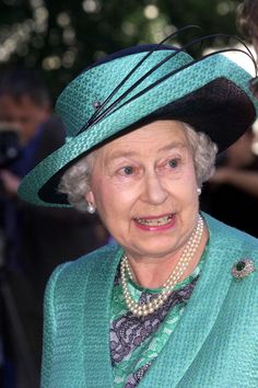 Queen Elizabeth, 2002 Beautiful Color on Her.   LOVE THE HAT band Style !
