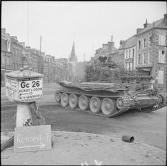 A Cromwell tank of Northamptonshire Yeomanry, Armoured Division, driving through Vassy, France, 15 August Churchill, Canadian Army, British Army, British Tanks, Cromwell Tank, D Day Normandy, Tank Armor, Military Armor, Military Pictures