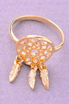 Our bohemian inspired Dreamcatcher Ring is gold plated metal. It features a small dreamcatcher at the center of the ring, with three tiny dangling metal feathers. Fits US standard ring size 6-7. DETAI                                                                                                                                                                                 More