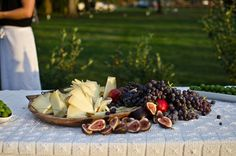Manchego cheese display with fresh fruit and castlevetrano olives.