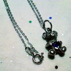http://www.bonanza.com/listings/Vintage-Sterling-Silver-Teddy-Bear-Charm-Pendant-with-Blue-Sapphire-Heart-925/114917847