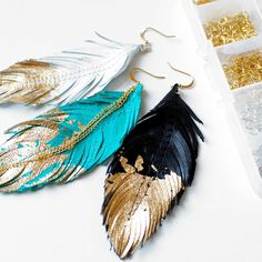 Leather Feather Earrings by Love at First Blush