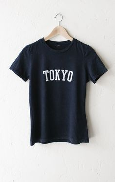 """- Description Details: Relaxed t-shirt in acid wash black with print featuring 'Tokyo' by NYCT Clothing. Measurements: (Size Guide) S: 37"""" bust, 25.5"""" length M: 40"""" bust, 26.0"""" length L: 44"""" bust, 26."""