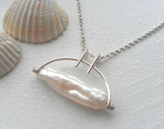 White Biwa Pearl Trapeze Necklace in Sterling Silver. $60,00, via Etsy.