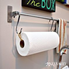 Paper towel holder. Just rope with knotted loops at both ends to slip over an S hook. Might be the solution to towels coming off holder.