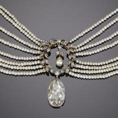 A belle époque diamond and seed pearl choker, circa 1900 The central pearl, single and rose-cut diamond garland, suspending an associated pear-shaped diamond drop, on an eight-row seed pearl necklace, connected by two smaller garland motifs, to a four-row seed pearl backchain and a four-stone rose-cut diamond clasp, principal diamond approximately 3.30 carats