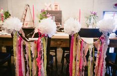 great idea for pompom wedding- pompom chairs  Pretty in Pink Wedding: Katie + Peter