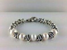 Beautiful Trollbead bracelet with focus on pearls and silver.