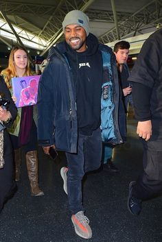 Kanye West wearing Supreme FW15 Uptown Down Parka, Fan Merchandise Yeezus Tour Hoodie, Rei Knit Beanie, Adidas Season 3 Yeezy Boost 350