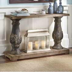 "Drawing inspiration from ancient Greece architecture, this elegant console table is supported by two distressed columns. Has an embossed leaf motif on the columns and planking on the solid wood top and bottom. Resin columns. Assembly required. 47 1/4"" l x 15 1/2"" w x 30 1/2"" h."