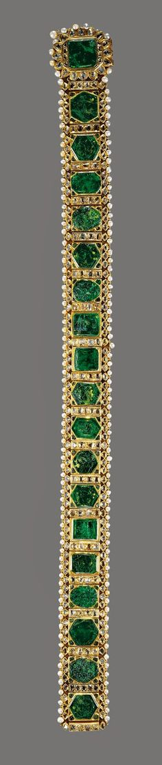 """The Lahore Emerald Girdle, c. 1840.  The emeralds in this exquisite piece were inherited by India's Maharajah Sher Singh from Ranjit Singh, his father known as the """"Lion of the Punjab.""""  """"The Lion,"""" it is said, had used the emeralds to decorate his horse harnesses.  The maharajah had the emeralds made into this exceptional girdle circa 1840.  Nine years later, the Directors of the East India Company obtained the belt and presented it to Queen Victoria in 1851."""