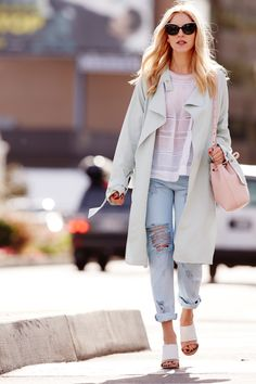 The perfect spring outfit: pastel trench, lightweight peasant top, distressed boyfriend jeans, pale pink bag, and white mules #StreetStyle