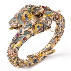 Antique Cloisonné Enamel Dragon Bangle Bracelet This lavishly ornamented antique bracelet is artistically crafted in solid rose gold and weighs grams. This impressive bracelet features two dragon heads with fine gold tongues and fiercely sharp t Antique Bracelets, Bangle Bracelets, Bangles, Enamel Jewelry, Jewellery, Dragon Head, Gold Texture, Rose Gold, Jewels