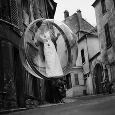Melvin Sokolsky captured his iconic Bubble series for Harper's Bazaar in 1963.Simone D'Aillencourt dons vintage fashion in various parts of Paris while a crane holds up the bubble to create the illusion of floating.