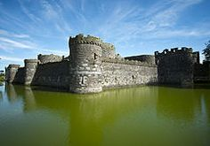 Beaumaris (/bjuːˈmærᵻs/; Welsh: Biwmares [bɪuˈmɑːrɛs]) is a former royal borough, a community, and the former county town of Anglesey, Wales. It was located in the commote of Dindaethwy and historic rural deanery of Tindaethwy, and is at the eastern entrance to the Menai Strait, the tidal waterway separating Anglesey from the coast of North Wales. ~ Wikipedia