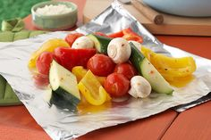 Scootch over the burgers and make room for this flavorful, better-for-you side. Ripe veggies steam in their own juices and zesty dressing in a no-mess foil pack.